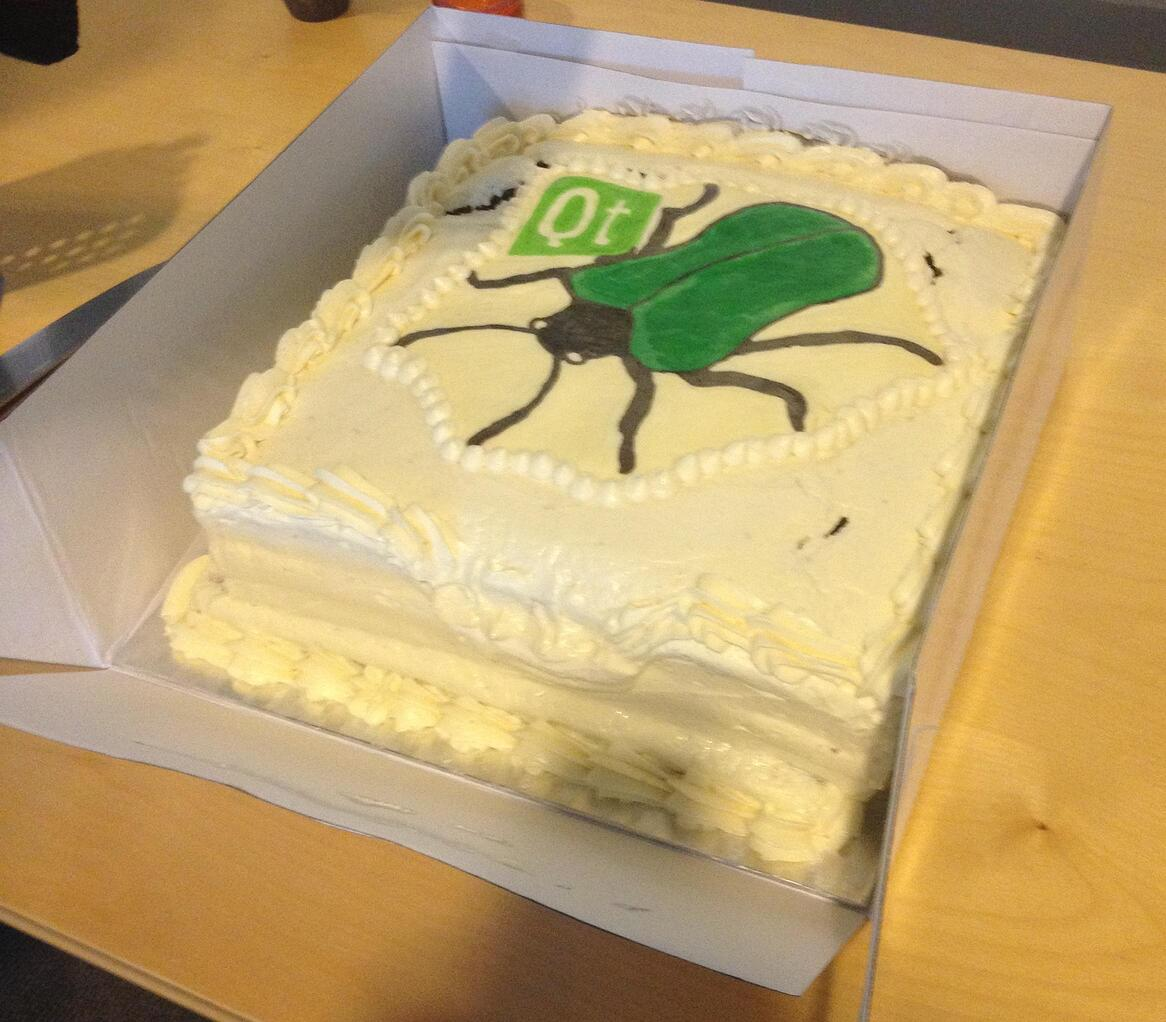 Cake with Qt logo and bug on the icing